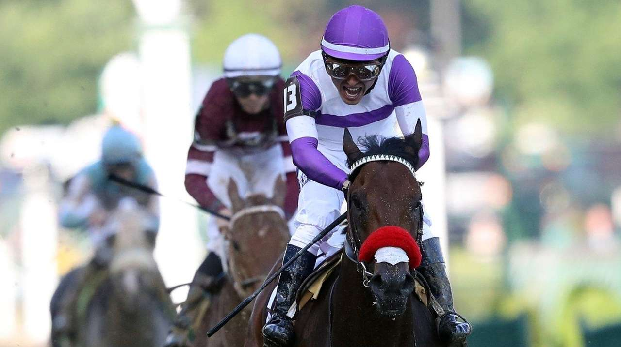 Nyquist, ridden by Mario Gutierrez, crosses the
