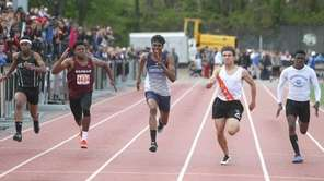 Gregory Matzelle of Carey wins the 100-meter dash