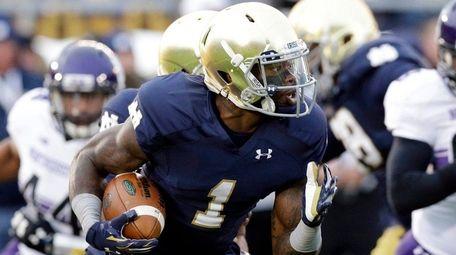 Notre Dame running back Greg Bryant runs