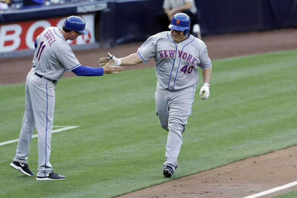 New York Mets' Bartolo Colon is greeted by