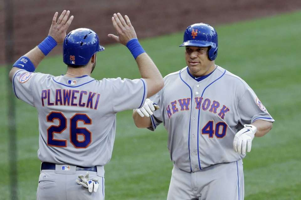New York Mets' Bartolo Colon, right, is greeted