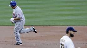 New York Mets' Bartolo Colon, left, rounds the