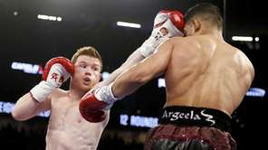 Canelo Alvarez, left, hits Amir Khan during their