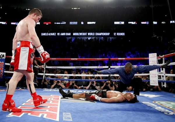Canelo Alvarez, left, watches after knocking down Amir