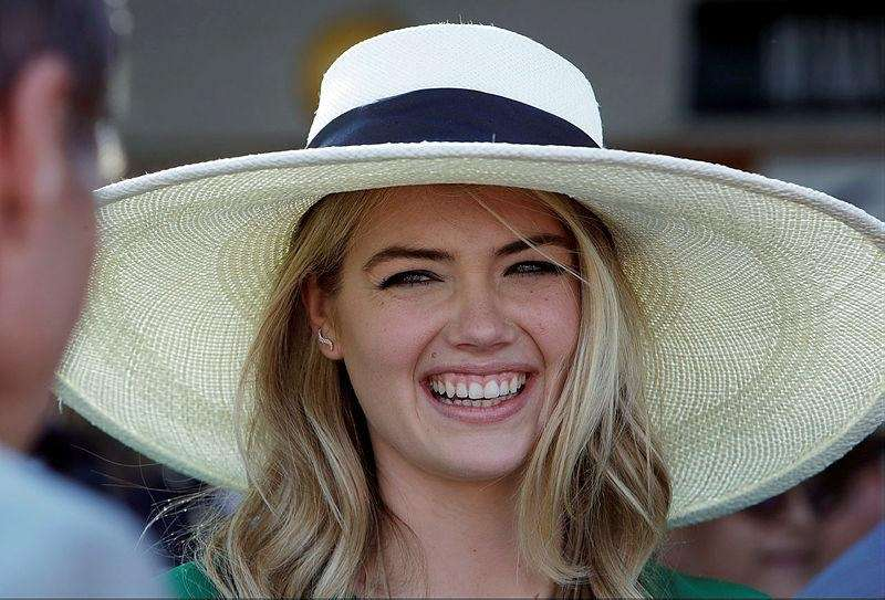 Kate Upton smiles in the paddock before the