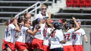 Stony Brook's Kasey Mitchell #15 celebrates with teammates
