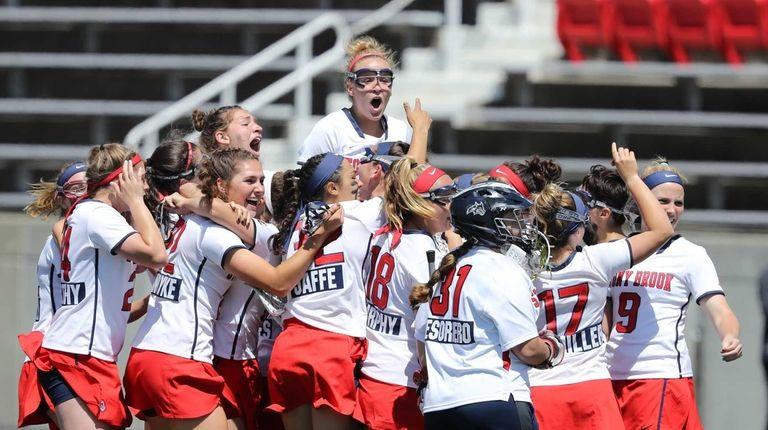 Stony Brook's Kasey Mitchell #15 celebrates with teammates