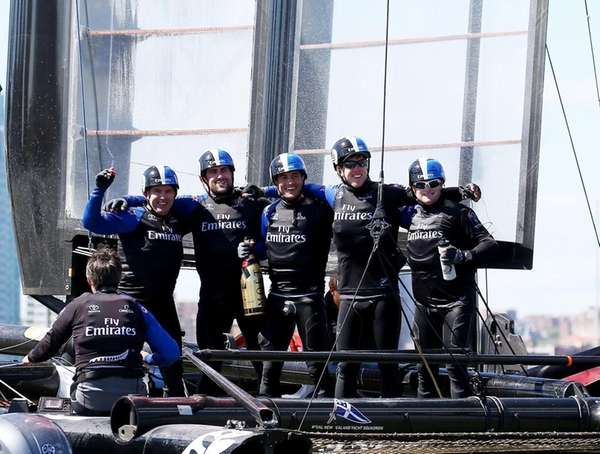 Emirates Team New Zealand celebrates the win during