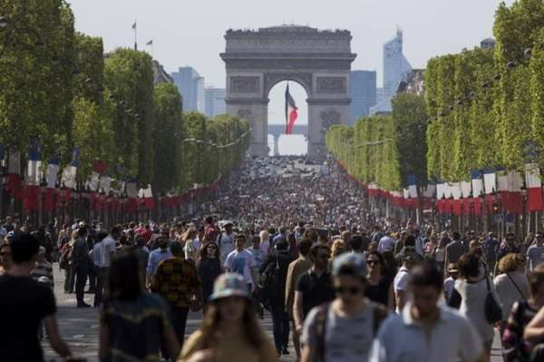 People walk on the Champs Elysees in Paris,