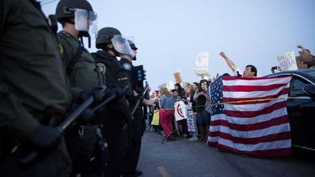 Protesters opposed to Republican presidential candidate Donald Trump