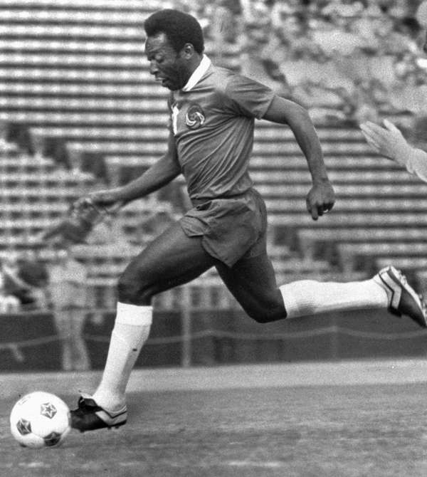 Brazilian soccer star Pele foots the ball during
