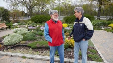 Fred Drewes, left, a park volunteer, and Tom