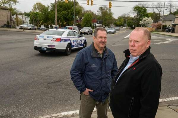 Community activists Robert Rockelein, left, and Jim McGoldrick,
