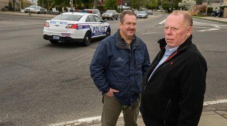 Community activists Robert Rockelein, left, and Jim McGoldrick,