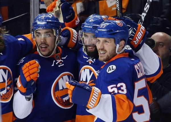 New York Islanders' Travis Hamonic, Nick Leddy and