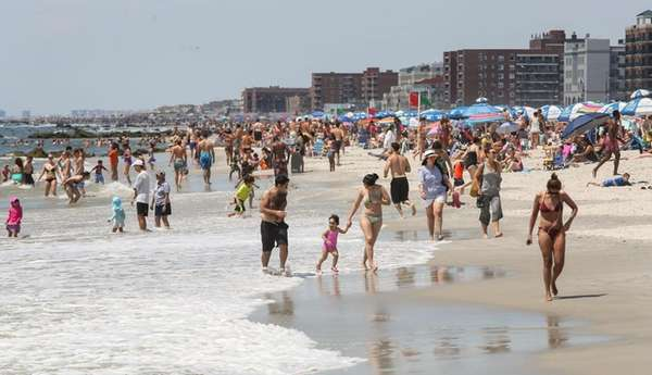 Beachgoers take to Long Beach Saturday, July 25,