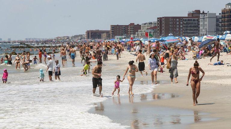 Beachgoers take to Long Beach Saturday, July 25,