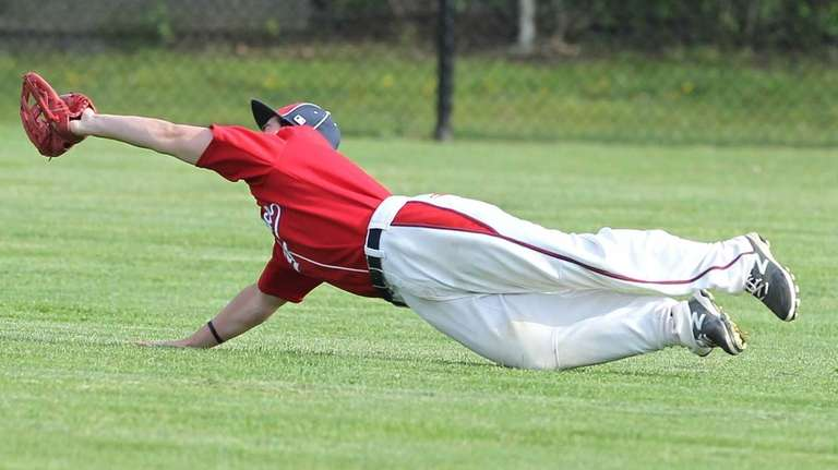 Miller Place's Kevin Kelleher (7) makes a diving
