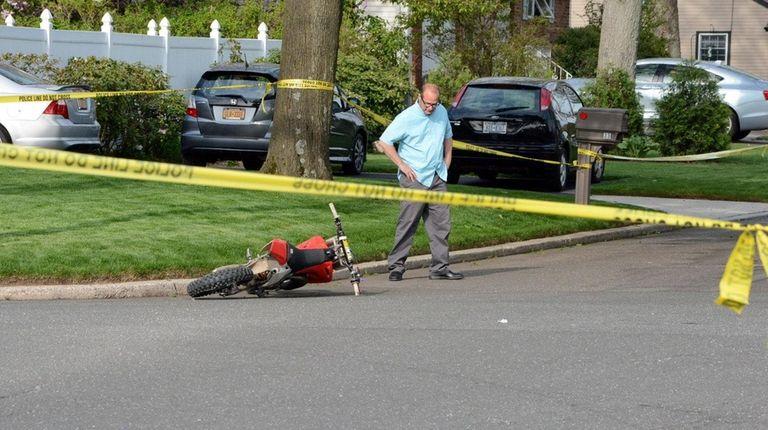 A dirt bike on the street in Selden