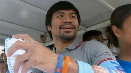 Manny Pacquiao in a campaign vehicle during a