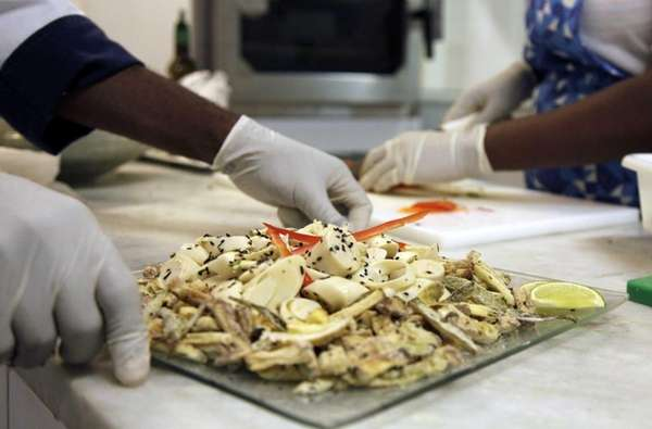 Cooks prepare meals during the food-testing of the