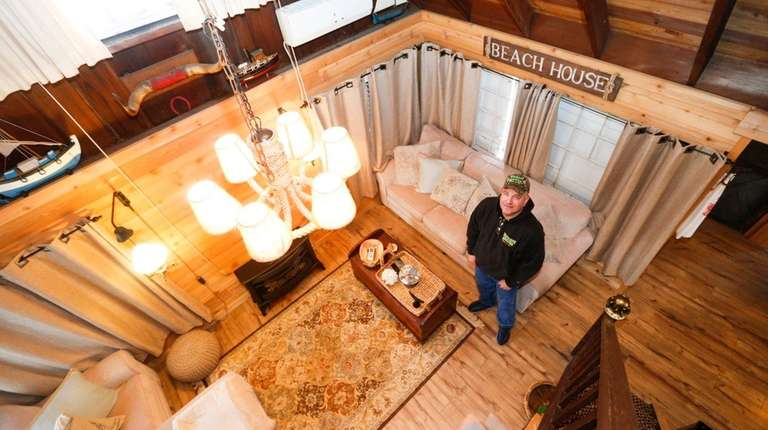 Dean Denninger stands in the living area of