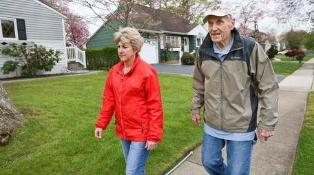 William Reuschle and his daughter Erin Madden walk