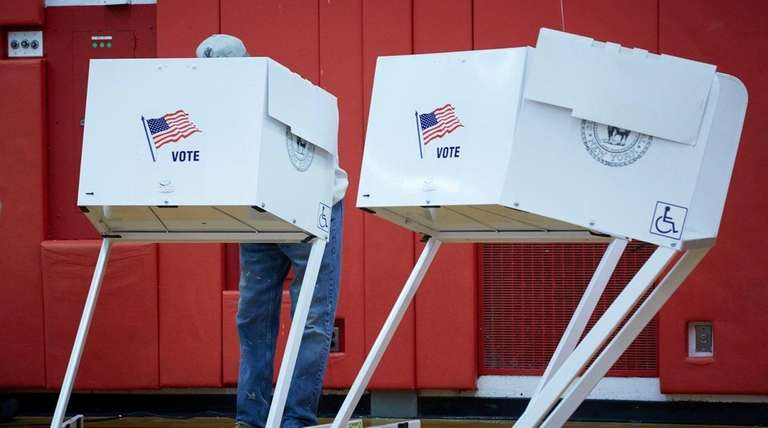 A voter marks a ballot at Great Hollow