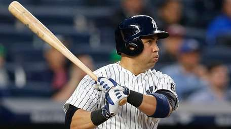 New York Yankees Carlos Beltran reacts as he