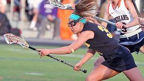Wantagh's Nikki Sliwak scores during a Nassau girls