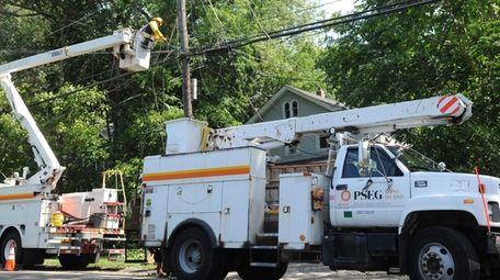 A PSEG Long Island utility worker works on