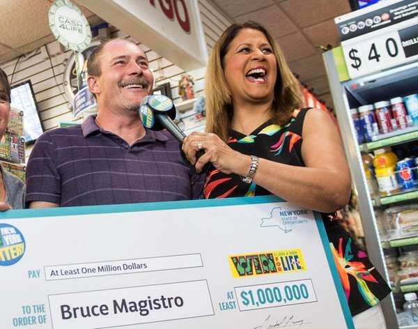 Bruce Magistro accepts a ceremonial check from New