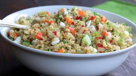 Quinoa with radishes, orange peppers, cucumbers and feta