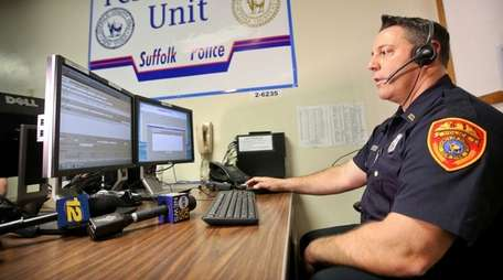 Suffolk Police Officer David Belli demonstrates the department's