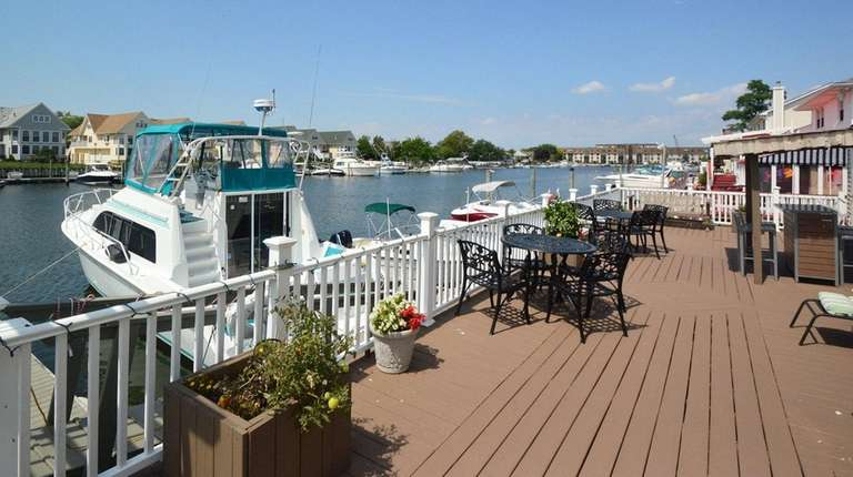 The boat backs up to the deck at