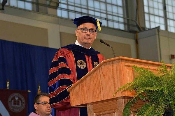 Dr. George Santiago, Jr., College President gives the