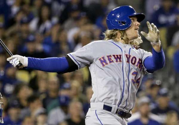 Noah Syndergaard watches his three-run home run during