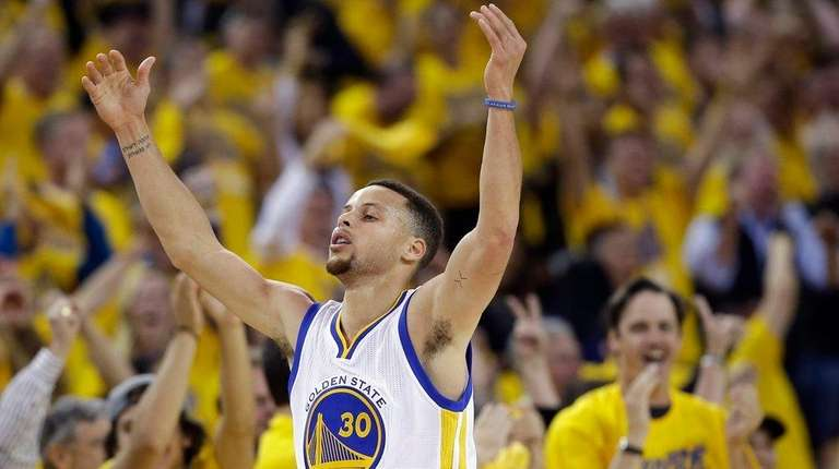 Golden State Warriors' Stephen Curry celebrates after scoring