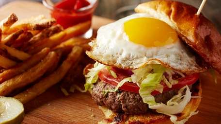 The burger with fried egg on brioche is
