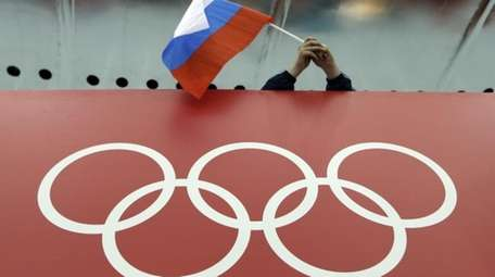A Russian fan holds the country's national flag