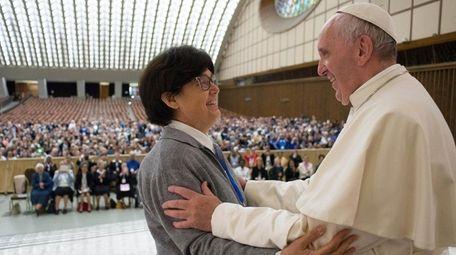 Pope Francis embraces Sister Carmen Sammut at the
