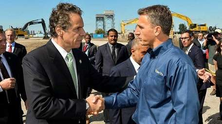 Gov. Andrew M. Cuomo with Lyndon Rive, co-founder