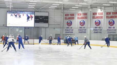 The New York Islanders skate during their first