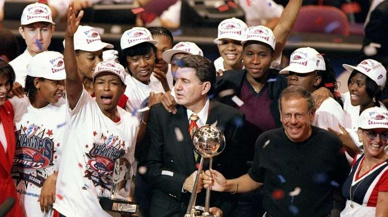 The Houston Comets celebrate after the WNBA championship