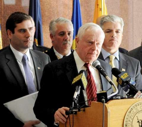 Burke is joined at a news conference by Burke, center. Credit: James Carbone