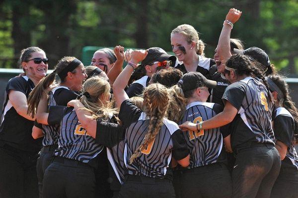 Adelphi softball teammates celebrate after their 4-1 win