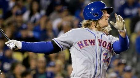 Mets pitcher Noah Syndergaard watches his three-run home