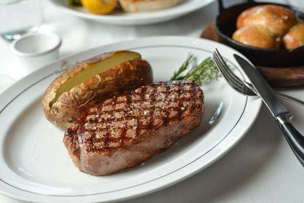 The 16-ounce New York strip steak is served