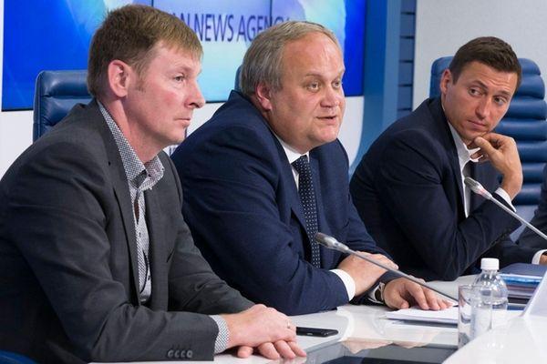 From left, bobsled champion Alexander Zubkov, deputy sports