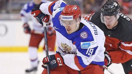 Pavel Buchnevich of Team Russia tries to break